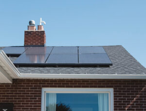 Fronius Inverters - solar panels on the roof of a residential building.