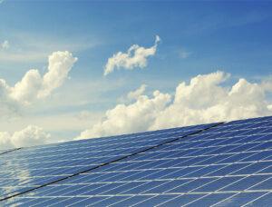 Jinko solar panels under clouds